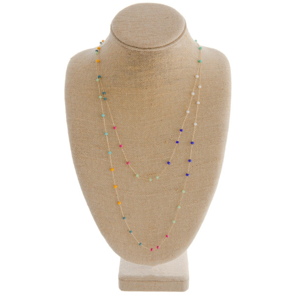 Long layered multicolored beaded necklace.