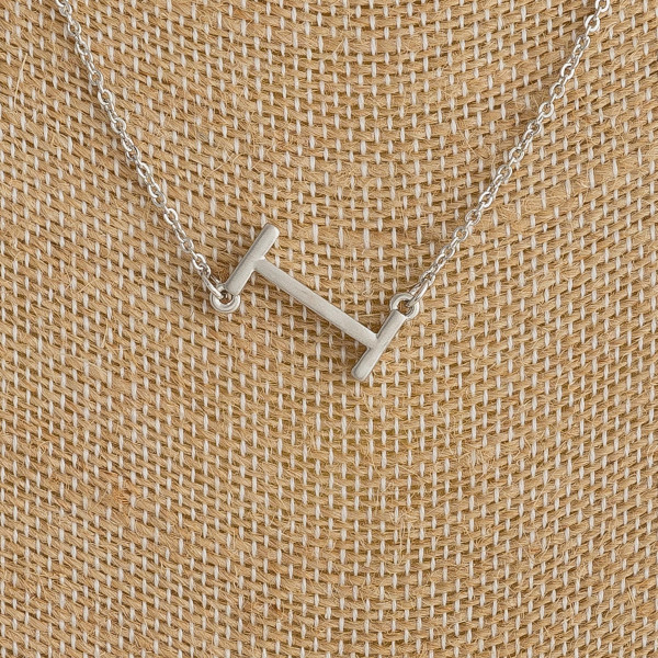 """Silver metal necklace featuring the initial """"I"""". Approximately 16"""" in length."""