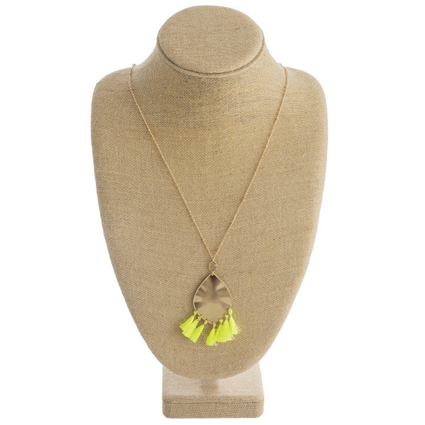 "Long metal necklace featuring a metal plated teardrop pendant with neon tassel details and gold accents. Pendant approximately 3"". Approximately 36"" in length overall."