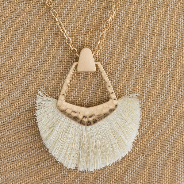 """Long cable chain necklace featuring a metal pendant with tassel details. Pendant approximately 3"""". Approximately 34"""" in length overall."""