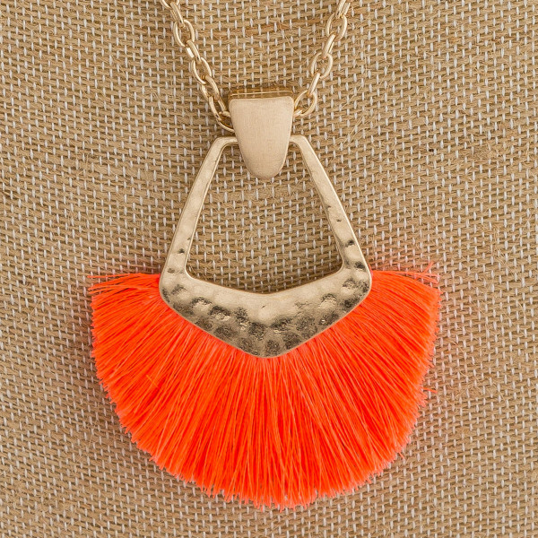"Long cable chain necklace featuring a metal pendant with neon tassel details. Pendant approximately 3"". Approximately 34"" in length overall."