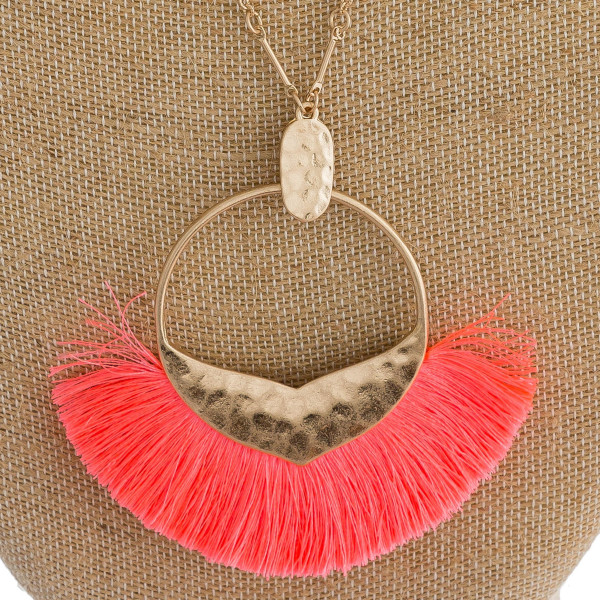 """Long cable chain necklace featuring a circular metal pendant with a mermaid tale detail and neon tassel accents. Pendant approximately 3.5"""". Approximately 40"""" in length overall."""