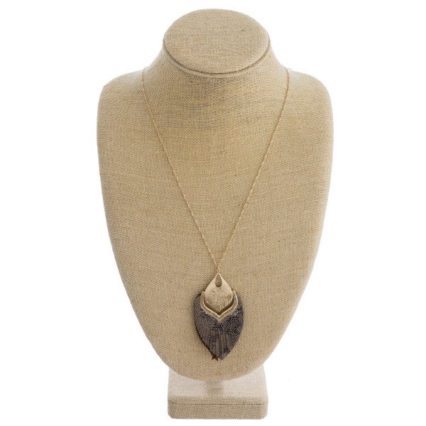 "Long singapore chain necklace featuring a faux leather feather inspired pendant with snakeskin details and gold metal accents. Pendant approximately 4"". Approximately 38 "" in length overall."