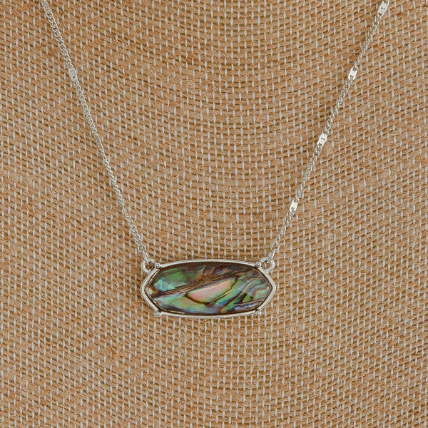 """Silver chain necklace featuring an abalone shell stone. Approximately 18"""" long."""