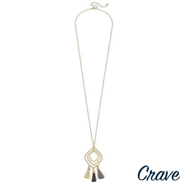 """Long chain necklace featuring a lotus inspired pendant with grey fanned tassel details. Pendant approximately 3"""". Approximately 34"""" in length."""