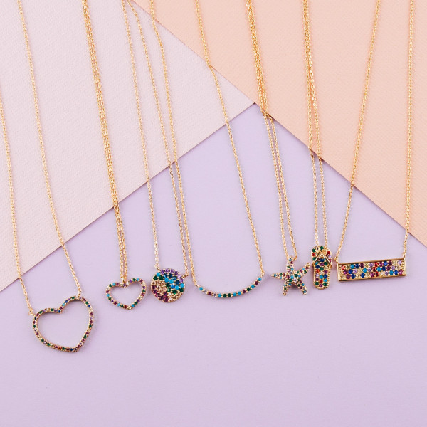 "Dainty metal necklace featuring a heart pendant with multicolor cubic zirconia details. Pendant approximately .5"". Approximately 18"" in length overall."
