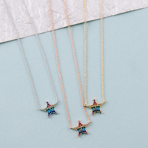 """Dainty cable chain necklace featuring a star pendant with multicolor cubic zirconia details. Pendant approximately .5"""". Approximately 18"""" in length overall."""