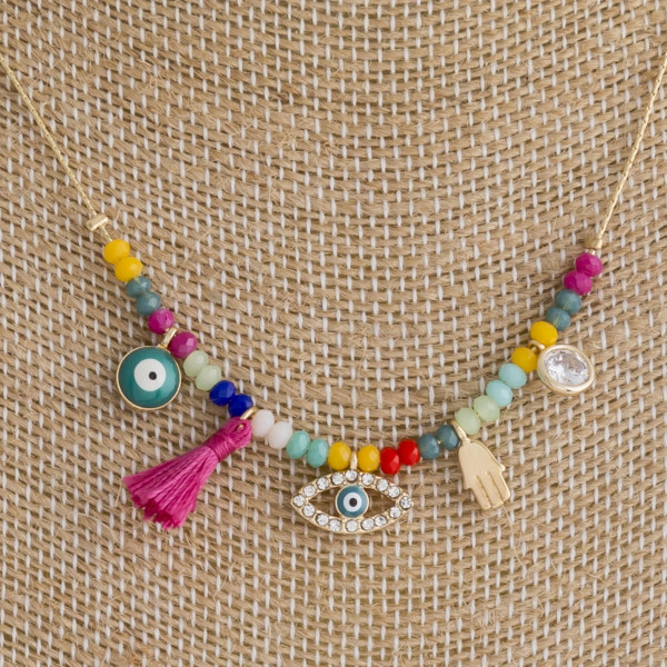 """Dainty metal necklace featuring traditional good luck charms with beaded details. Approximately 16"""" in length."""