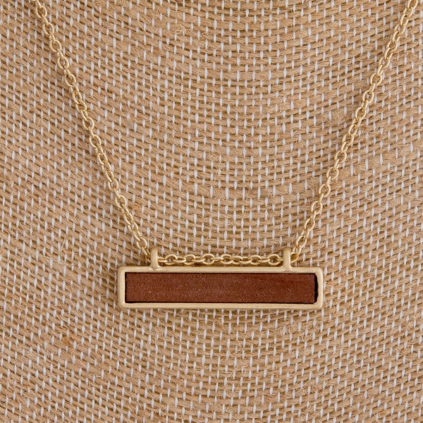 "Cable chain necklace featuring a bar pendant with a wood center detail. Pendant approximately 1.5"". Approximately 16"" in length overall."