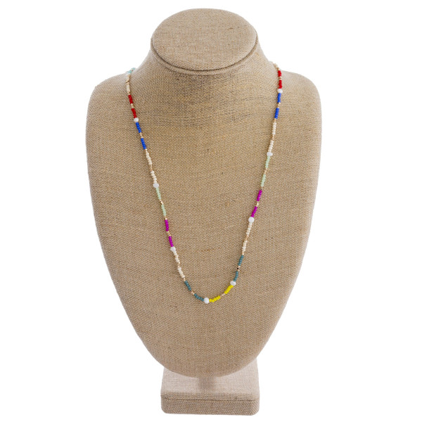 """Long beaded necklace featuring wood and pearl beaded accents. Approximately 30"""" in length."""