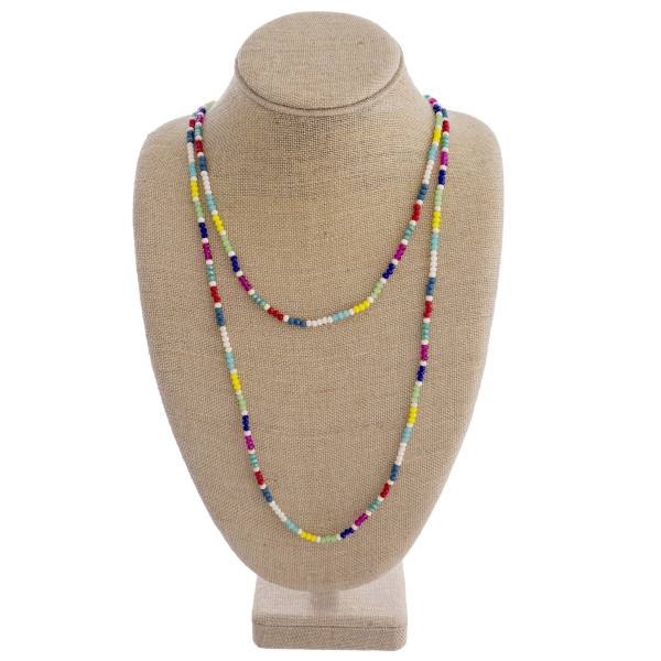 """Long two layered necklace featuring multicolor faceted beads with wood accents. Shortest layer 22"""". Approximately 35"""" in length overall."""