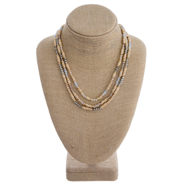 """Trio layered wood beaded necklace featuring natural faceted beads and gold accents. Approximately 16"""" in length."""