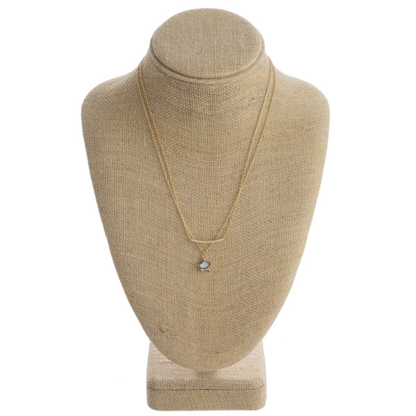 """Layered gold necklace featuring a curved bar accent and a small blue abalone shell star pendant. Approximately 18"""" in length."""