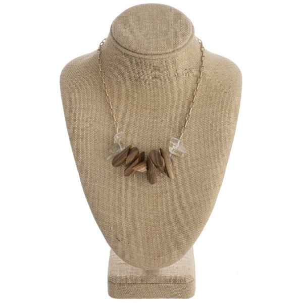 """Oval chain link necklace featuring wood and natural beaded accents. Approximately 16"""" in length"""