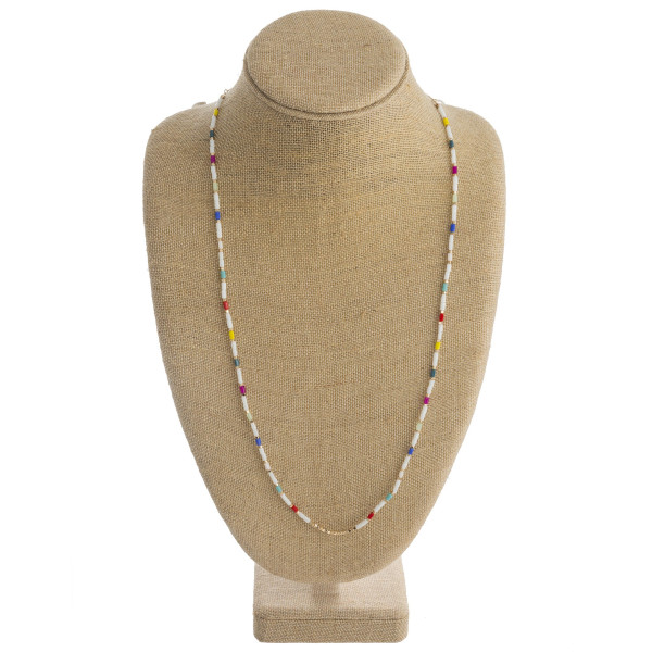 """Long beaded necklace featuring gold details and multicolored accents. Approximately 30"""" in length."""