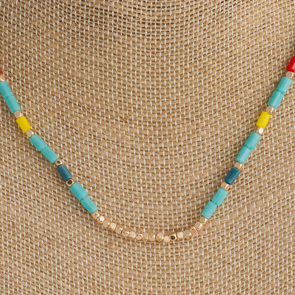 "Short multicolored necklace featuring beaded accents. Approximately 16"" in length."