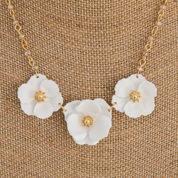 "Dainty cable chain necklace featuring a trio flower pendant with gold center accents and iridescent beaded details. Pendant approximately 2.5"". Approximately 16"" in length overall."