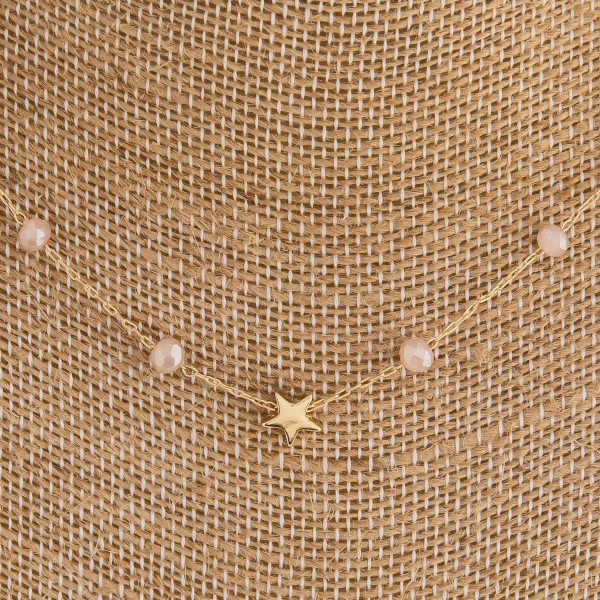 "Dainty oval link chain necklace featuring iridescent bead details and gold star accents. Approximately 16"" in length."