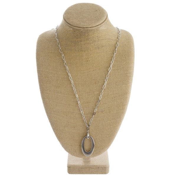 """Long oval link chain necklace featuring a metal oval pendant. Pendant approximately 2.5"""". Approximately 36"""" in length."""