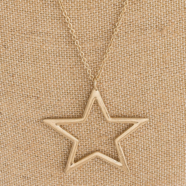 "Long cable chain necklace featuring a star pendant. Pendant approximately 2"". Approximately 34"" in length overall."