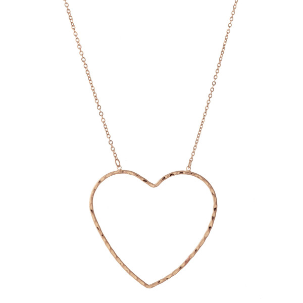 """Dainty cable chain necklace featuring a heart pendant. Pendant approximately 2"""". Approximately 20"""" in length overall."""