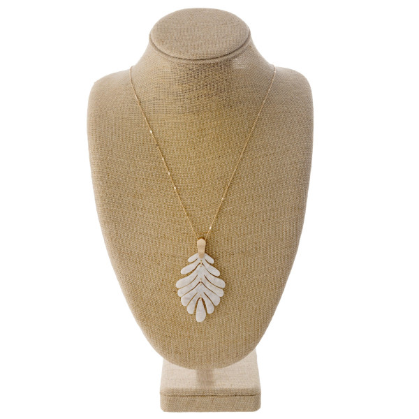 "Long dainty chain necklace featuring a flexible resin inspired leaf pendant. Pendant approximately 3.5"". Approximately 36"" in length overall."