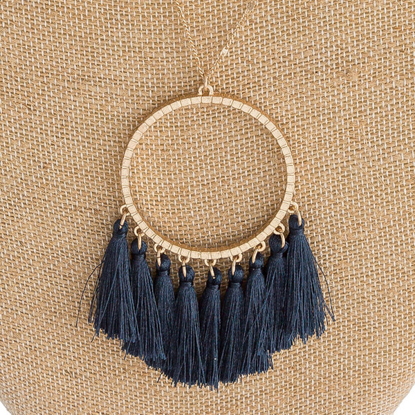 """Long dainty chain necklace featuring a circular pendant with thread fan tassel details. Pendant approximately 3"""". Approximately 36"""" in length overall."""