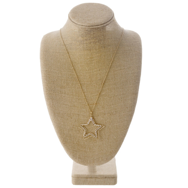 "Long dainty cable chain necklace featuring a trio layered star pendant. Pendant approximately 2"". Approximately 34"" in length overall."