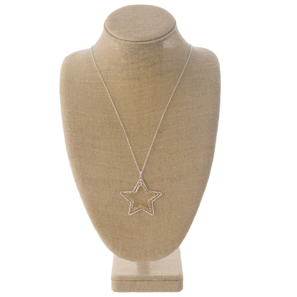 """Long dainty cable chain necklace featuring a trio layered star pendant. Pendant approximately 2"""". Approximately 34"""" in length overall."""
