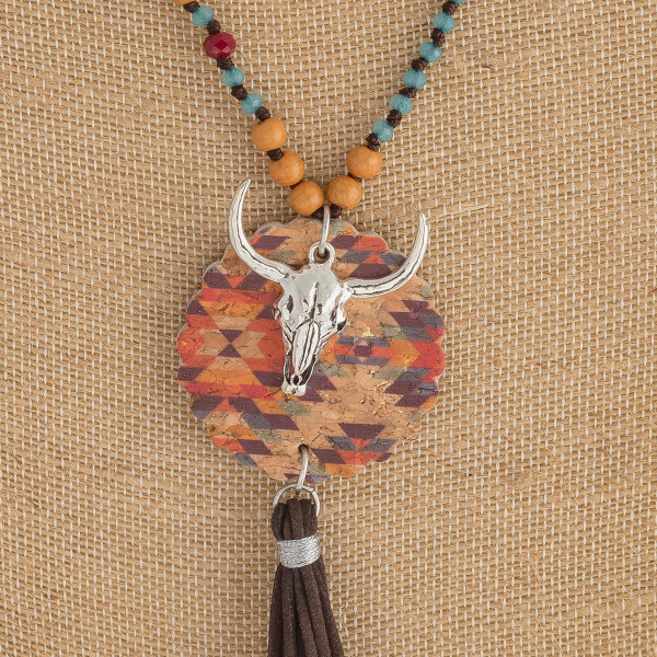 "Faux leather/beaded western style necklace featuring cork and tassel details. Approximately 34"" in length."