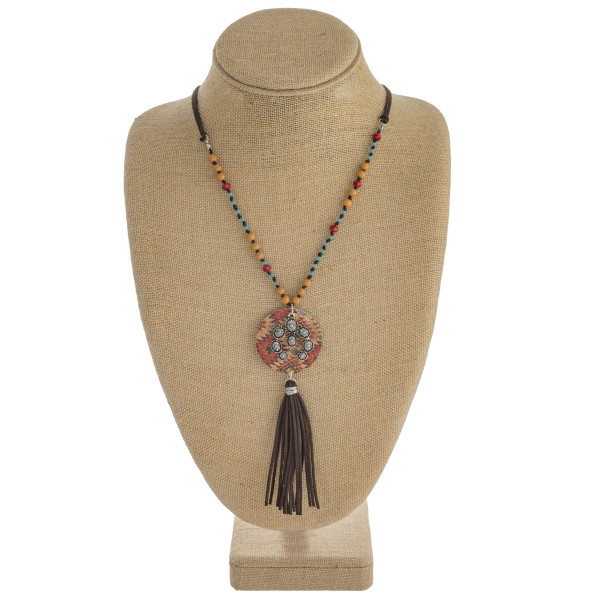 """Faux leather/beaded western style necklace with cork and tassel details. Approximately 34"""" in length."""