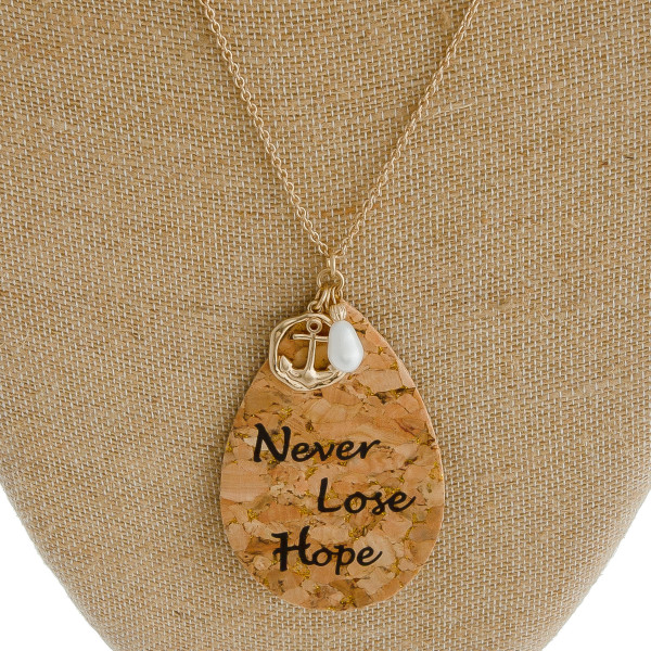 "Long cable chain necklace featuring a cork teardrop pendant with ""Never Lose Hope"" inspiring message with an anchor and pearl accent. Pendant approximately 3.5"". Approximately 38"" in length overall."