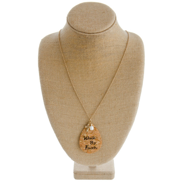 "Long cable chain necklace featuring a cork teardrop pendant with ""Walk By Faith"" inspiring message with a cross and pearl accent. Pendant approximately 3.5"". Approximately 38"" in length overall."