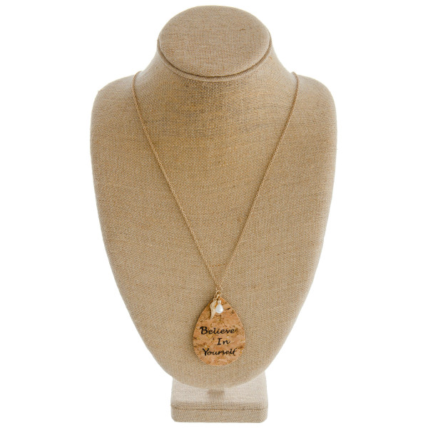 """Long cable chain necklace featuring a cork teardrop pendant with """"Believe In Yourself"""" inspiring message with an angel wing and pearl accent . Pendant approximately 3.5"""". Approximately 38"""" in length overall."""