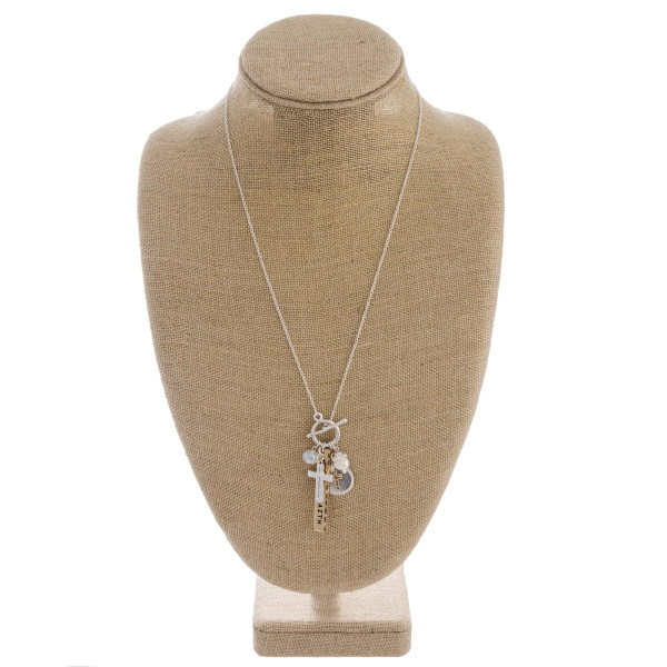 """Long dainty cable chain necklace featuring """"Walk by Faith"""" charm pendant with a front toggle clasp closure. Approximately 28"""" in length."""