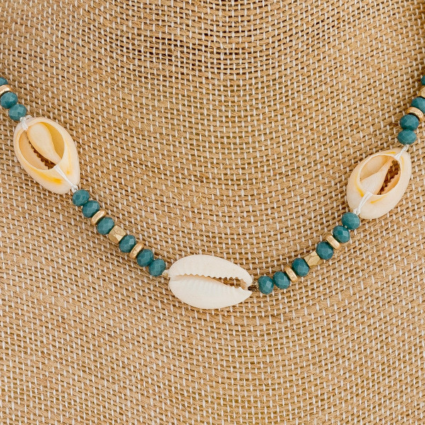 """Iridescent beaded choker featuring puka shell details and gold accents. Approximately 14"""" in length."""
