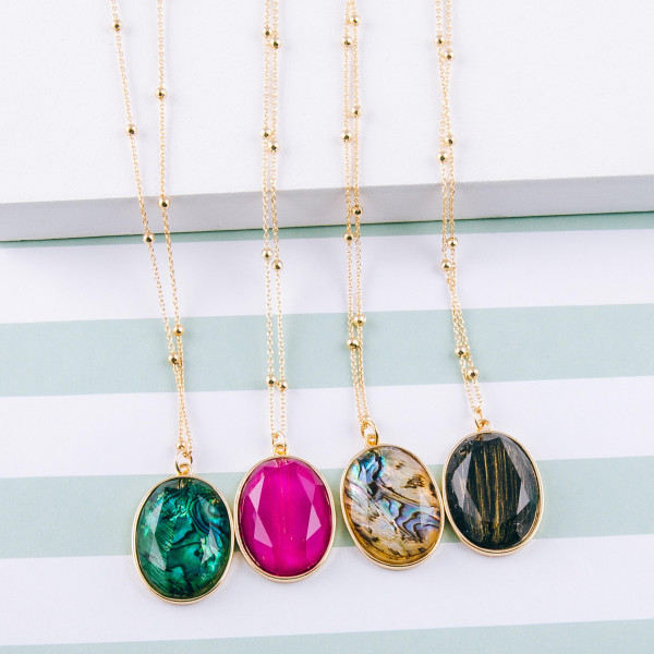 "Dainty satellite ball chain necklace featuring a iridescent acrylic stone pendant. Pendant approximately 1.5"". Approximately 26"" in length overall."