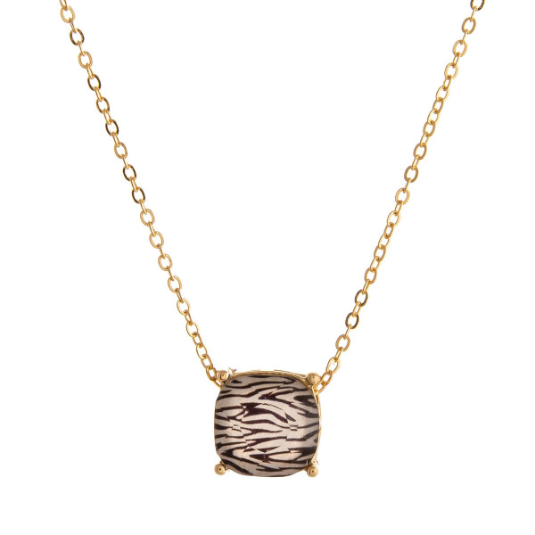 "Dainty cable chain necklace featuring a faceted acrylic stone pendant with zebra print details. Pendant approximately 1cm. Approximately 16"" in length overall."