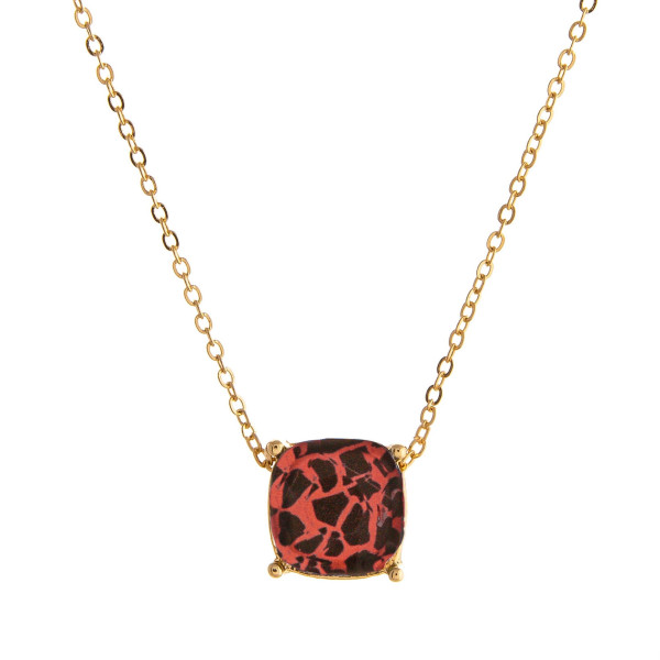 "Dainty cable chain necklace featuring a faceted acrylic stone pendant with leopard print details. Pendant approximately 1cm. Approximately 16"" in length overall."
