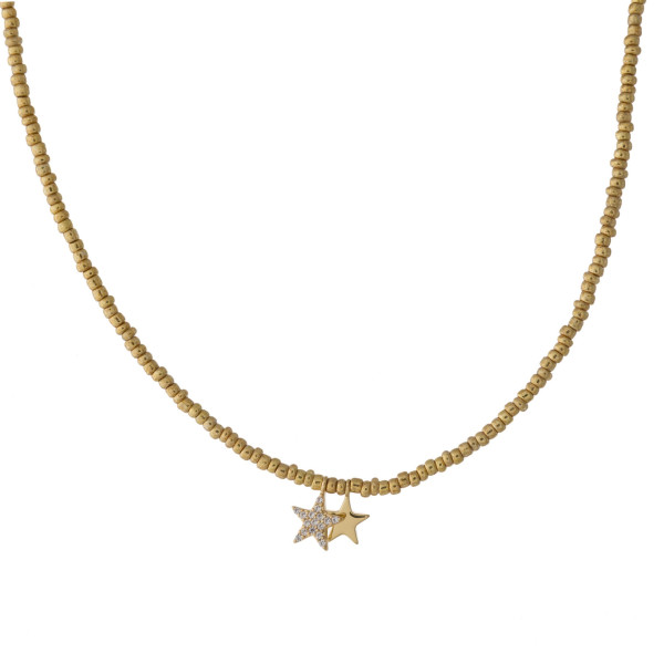 """Dainty seed beaded necklace featuring two star accents with cubic zirconia details. Approximately 16"""" in length."""