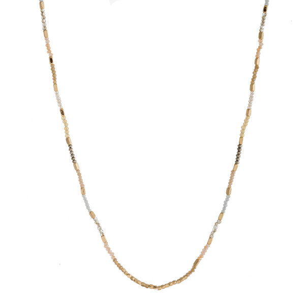 """Long dainty beaded necklace with faceted bead details and gold accents. Approximately 28"""" in length."""