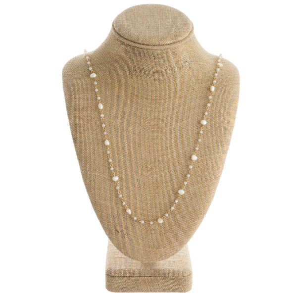 "Long beaded chain necklace featuring pearl and faceted bead details. Approximately 32"" in length."