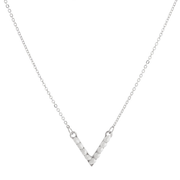 "Dainty cable chain necklace featuring a ""v"" shaped pendant with pearl beaded details. Pendant approximately .5"". Approximately 16"" in length overall."