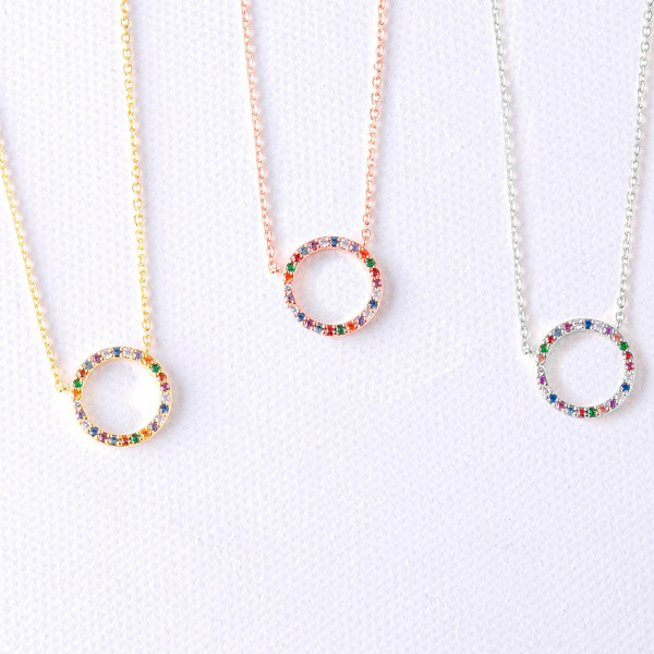 """Dainty cable chain necklace featuring a circular pendant with multicolor cubic zirconia details. Pendant approximately .5"""". Approximately 15"""" in length overall."""