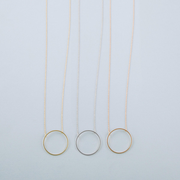 "Dainty cable chain necklace featuring a circular pendant. Pendant approximately 1"". Approximately 30"" in length overall."