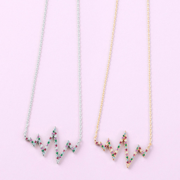 """Dainty cable chain necklace featuring a ekg inspired pendant with multicolor cubic zirconia details. Pendant approximately 1"""". Approximately 18"""" in length overall."""
