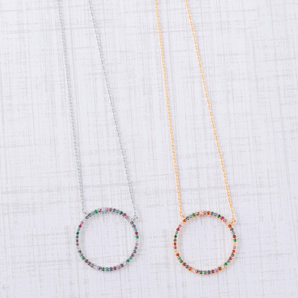 """Dainty cable chain necklace featuring a circular pendant with multicolor cubic zirconia details. Pendant approximately 1"""". Approximately 18"""" in length overall."""