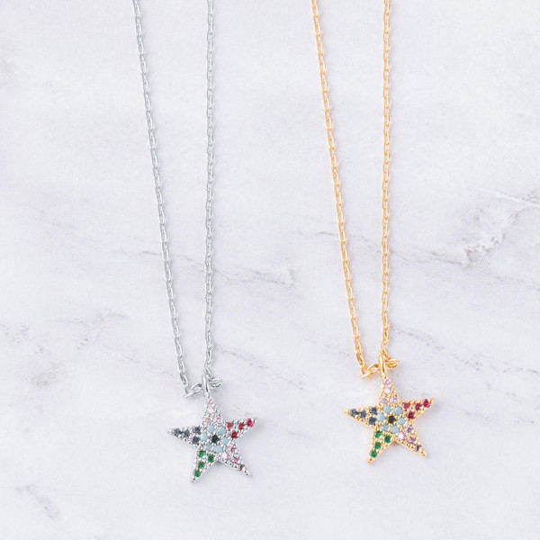 "Dainty cable chain necklace featuring a star pendant with multicolor cubic zirconia details. Pendant approximately 1cm. Approximately 18"" in length overall."