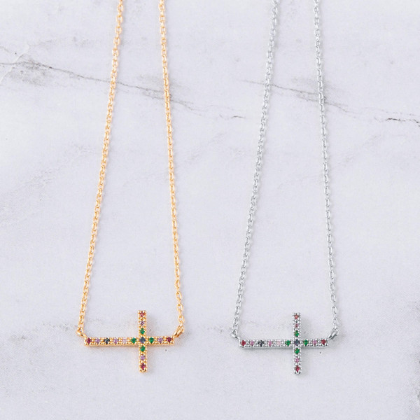 "Dainty cable chain necklace featuring a East West cross pendent with multicolor cubic zirconia details. Pendant approximately .5"". Approximately 18"" in length overall."