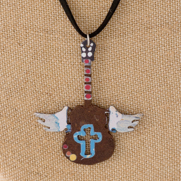 """Long black felt necklace featuring a guitar metal pendant with wings and cross details. Pendant approximately 3"""". Approximately 38"""" in length overall."""